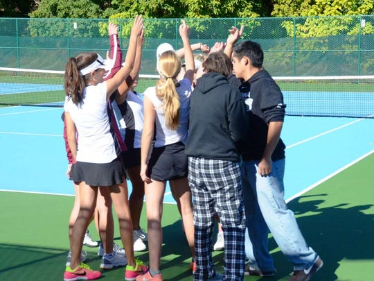 The Verona girls tennis team meets before the start of the Lady Hillbillies' state tournament win over Rutherford Friday afternoon, Oct. 14, 2016 at Verona High School.