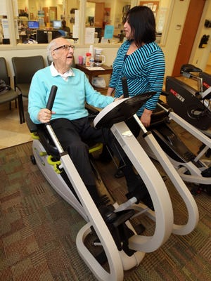 Philip Wagner from Armonk, 100-years-old, chats with his caregiver Monique Ayala at the Northern Westchester Hospital cardiac rehab facility at Chappaqua Crossing in Chappaqua, Feb. 24, 2017.