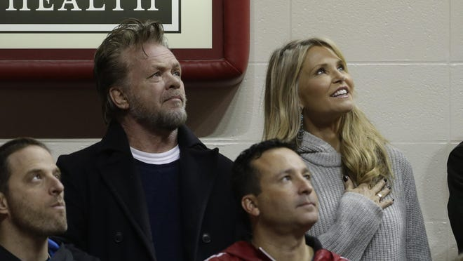 In this Jan. 23, 2016, file photo, John Mellencamp and Christie Brinkley attend an NCAA college basketball game between Indiana and Northwestern in Bloomington, Ind. A spokeswoman for both stars told The Associated Press on August 10, 2016, that they have ended their relationship after dating for about a year.