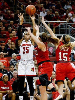 Louisville's Asia Durr pulls up for the three over WKU's Whitney Creech and Micah Jones. Dec. 11, 2016
