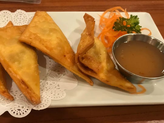 Spice Thai & Sushi's chicken curry puffs were hot, fried wontons filled with curry-spiced chicken and potatoes and served with Thai duck sauce.