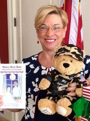 Janet Stone is both the creator of Henry Hero Bear and the author of the accompanying storybook, illustrated by Linda Glaser.