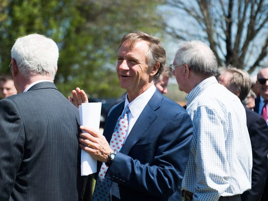 Gov. Bill Haslam walks through a crowd before the announcement