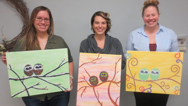 Stephanie Immel, Kim Keceli and Jackie Flanigan enjoyed being creative at the Campbellsport Public Library during a recent painting program led by Lisa from Painting Around the Bend. The library holds a variety of craft programs throughout the year. For more information, visit campbellsportlibrary.org.