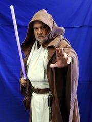 Tony Grove, owner of Tony's Kingdom of Comics, dresses as Obi-Wan Kenobi from Star Wars.