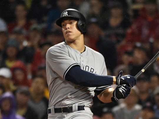 Yankees right fielder Aaron Judge hits a single during