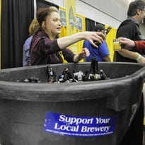 Kat Erickson serves samples at the Schell's Brewing booth during a past St. Cloud Craft Beer Tour.