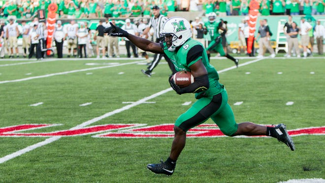 Sep 6, 2015; Huntington, WV, USA; Marshall Thundering Herd defensive back Keith Baxter (5) intercepts a pass late in the fourth quarter against the Purdue Boilermakers at Joan C. Edwards Stadium. Marshall won the game 41-31. Mandatory Credit: Ben Queen-USA TODAY Sports