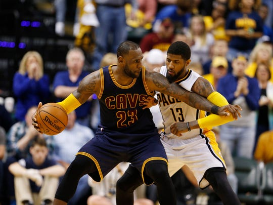 Apr 23, 2017; Indianapolis, IN, USA; Cleveland Cavaliers forward LeBron James (23) is guarded by Indiana Pacers forward Paul George (13) in game four of the first round of the 2017 NBA Playoffs at Bankers Life Fieldhouse. Cleveland defeats Indiana 106-102. Mandatory Credit: Brian Spurlock-USA TODAY Sports