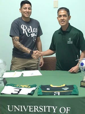 Tiffanie Rodrigues shakes hands with Rod Hidalgo, coach of the women's soccer team after committing to play soccer for the university.