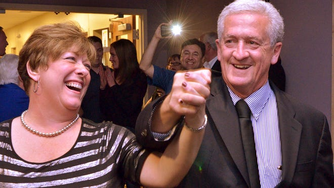 Former Livonia Mayor Dennis Wright and his wife Karen following his election in 2015.