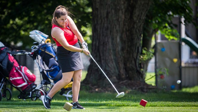 Wapahani's Abby Snider competes in the girls county golf tournament at Muncie Elks Saturday Aug. 11, 2018.