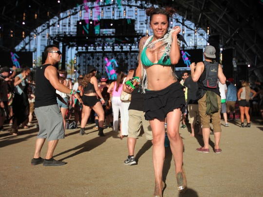Fans dance to GTA's performance in the Sahara tent on Saturday, April 19, 2014 during the second weekend of the Coachella Valley Music and Arts Festival in Indio, CA.
