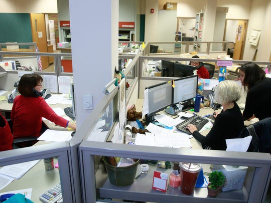 Election officials work on Nov. 8, 2016, at the San Juan County Clerk's Office.