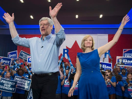 Conservative Party leader Stephen Harper and wife, Laureen, wave to the crowd during a campaign Saturday rally in Toronto.