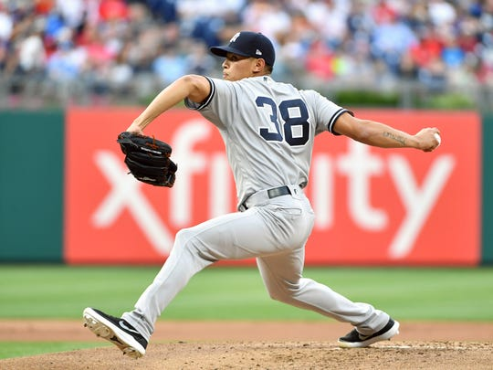 New York Yankees starting pitcher Jonathan Loaisiga (38) throws a pitch during the first inning against the Philadelphia Phillies at Citizens Bank Park.
