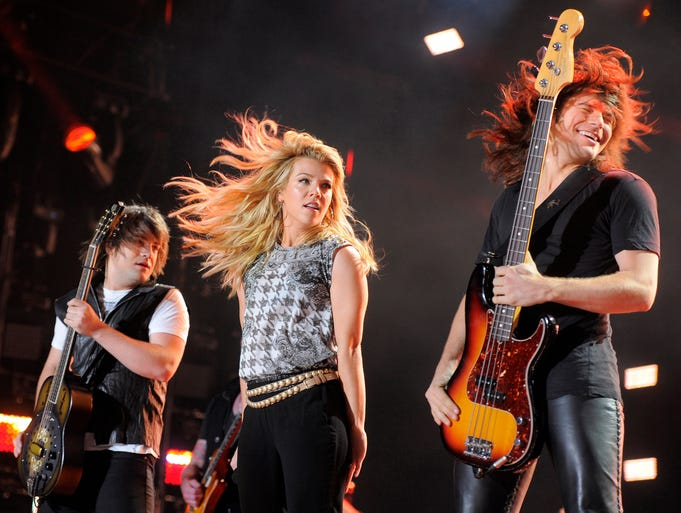 The Band Perry, Neil, Kimberly, and Reid Perry (left to right), performs at CMA Fest at LP Field Friday June 6, 2014, in Nashville, TN.