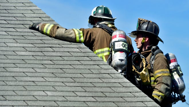 Firemen check the roof for damageges at a house fire at 59 Keystone Av., Guilford Township on Thursday, September 15, 2016.