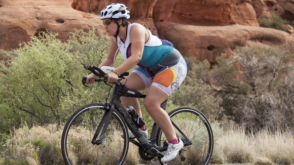 Spectrum Audience Analyst Casie Forbes prepares for the upcoming Ironman race by cycling up Snow Canyon State Park Saturday, March 5, 2016.