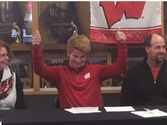 Stratford's Jeremy Schoenherr gives the thumbs up after signing his letter of intent with the Wisconsin wrestling program Wednesday.