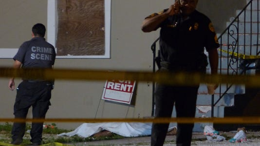 Authorities work the scene of a deadly shooting in Miami's Liberty City neighborhood.