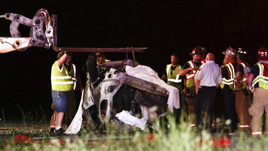 Police and rescue personnel are shown at the scene of a deadly crash in Nicholasville, Ky.