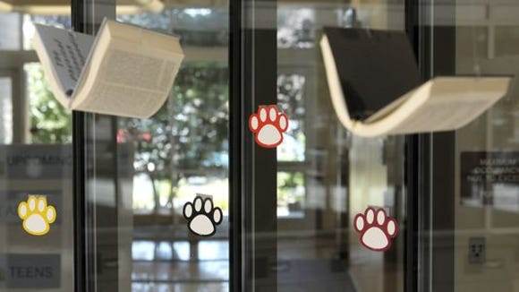 """""""Paws to Read,"""" the Tulare Public Library's summer reading program encourages children and adults to read with prizes offered and runs through July 27."""