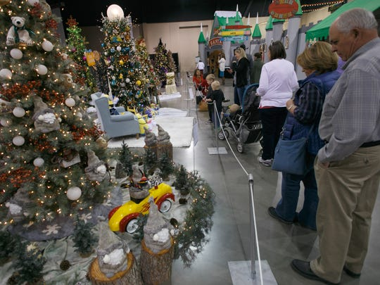 Spectators at the 2014 Jubilee of Trees look over the displays at the Dixie Center in St. George.