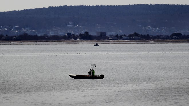 Baymen like this, seen in Duxbury Bay on March 20, 2018, could be a common sight in Briggs Harbor, in Scituate, after a controversial plan to lease tide flats for shellfishing. Greg Derr/ The Patriot Ledger