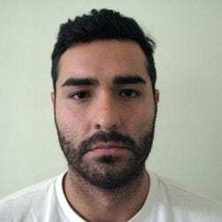 In this photo provided by Mexico's attorney general's office, fugitive former Los Angeles police officer Henry Solis, 27, is seen after he was captured by Mexican security forces in the border city of Ciudad Juarez, May 26, 2015.