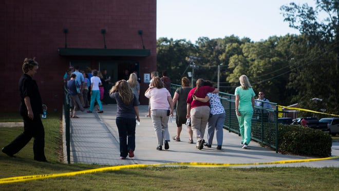 People gather at Townville Elementary School on Wednesday afternoon after two students and a teacher were shot.