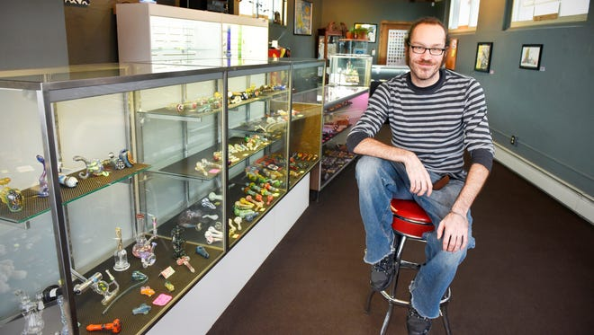 Travis Pinney, co-owner of Trepanation Art Gallery, has a wide variety of handblown glass pipes and artwork available Friday, Nov. 20 located in the old Flatiron building.