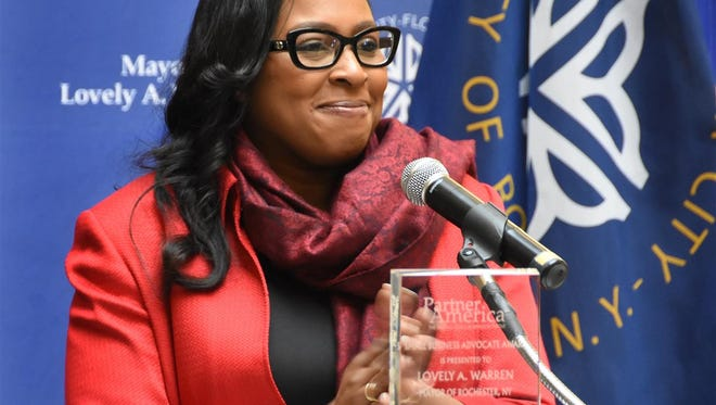 Mayor Lovely Warren accepts a small business advocate award Thursday, April 20, 2017, from Partner America, a public-private partnership formed by The U.S. Conference of Mayors.