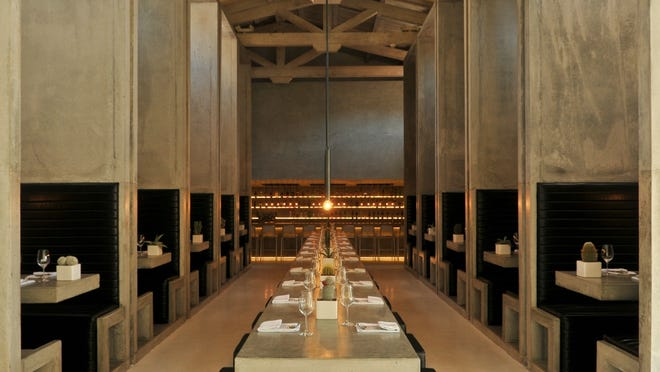 A 25-foot communal cement table bisects the long dining hall in Workshop.