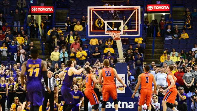Northern Iowa Panthers guard Wes Washpun (11) watches his game-winning shot at the buzzer go through the net to defeat the Evansville Aces in the championship game of the Missouri Valley Conference tournament at Scottrade Center. Northern Iowa defeated Evansville 56-54.