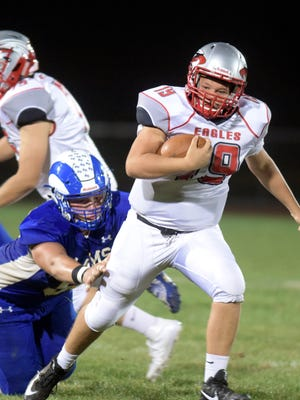 Dover quarterback Justin Johnson (19) runs the ball during Dover at Kennard-Dale football game Friday, Oct. 6, 2017. The Eagles won the game, 21-7, improving to 4-2 on the year and staying in first place in Division II at 3-0. Bill Kalina photo