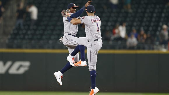 Houston Astros center fielder Cameron Maybin  and former Roberson standout became a World Series champion Wednesday night
