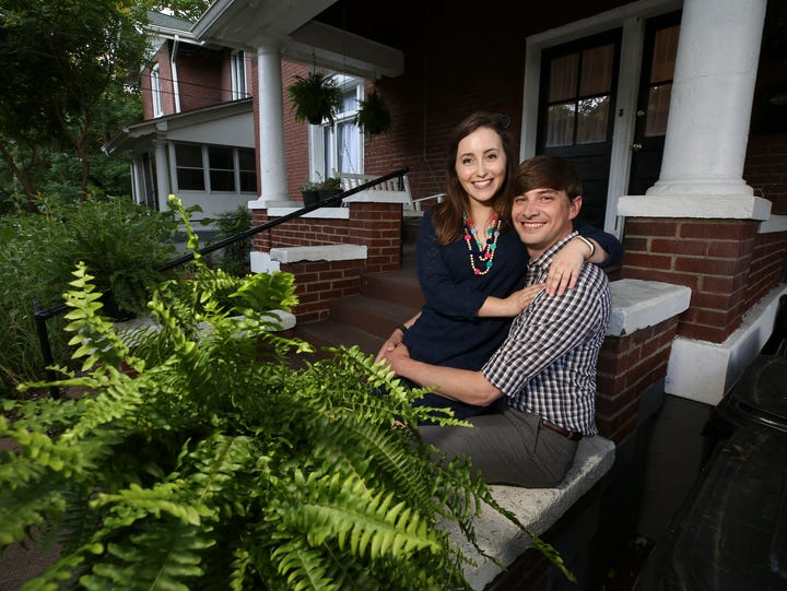 Alex Kenemer, right, and Marissa Leese sit on the porch