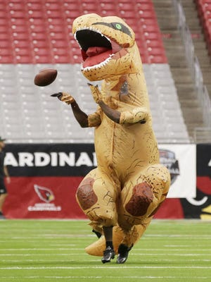 Patrick Peterson can even intercept passes dressed as a dinosaur.