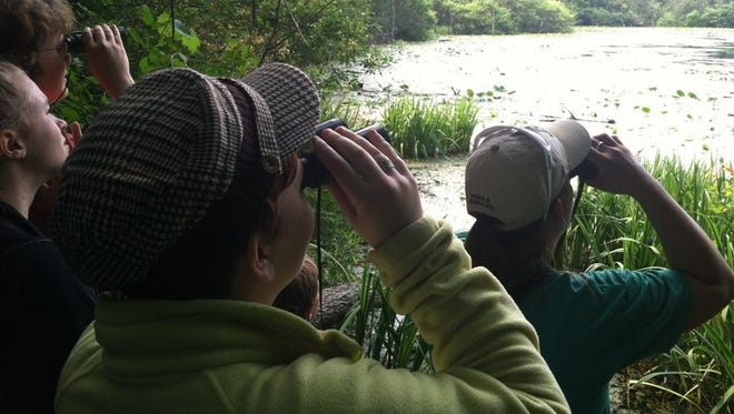 Holly Recreation Area explorer guide Courtney Prout leads a birding hike.