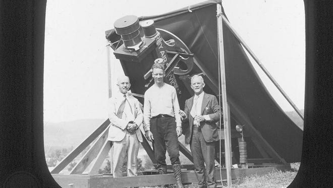 Cincinnati astronomers (left to right) Everett Yowell, Paul Herget, Elliot Smith with their telescopes in New Hampshire, ready to observe the Aug. 31, 1932 eclipse. Clouds hindered their observations of totality.