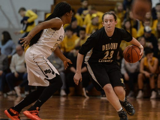 Delone Catholic's Ally Shipley drives to the hoop against
