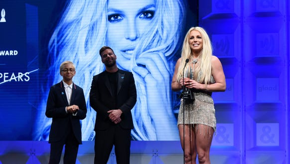 Britney Spears accepted the Vanguard Award from Ricky
