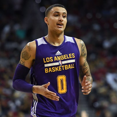 Lakers forward Kyle Kuzma smiles after hitting a three-pointer