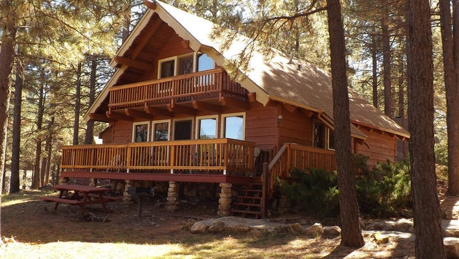 Most of the cabins at the Arizona Mountain Inn in Flagstaff sleep four to six people.