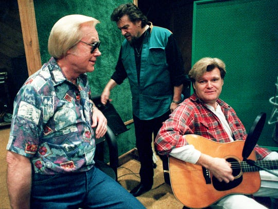 George Jones, left, relaxes at the Bradley's Barn Studio