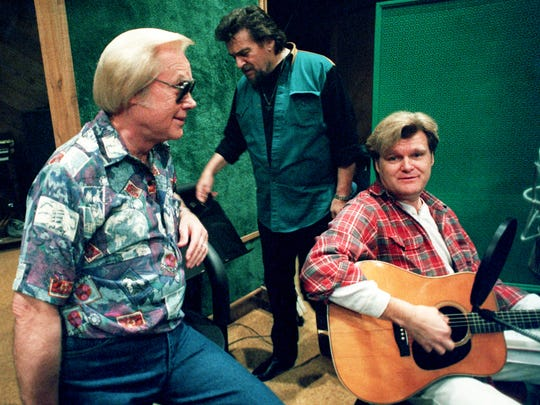 George Jones, left, relaxes at the Bradley's Barn Studio in Mt. Juliet on Feb. 20, 1994, during a recording session with some friends, including Waylon Jennings, center, and Ricky Skaggs.