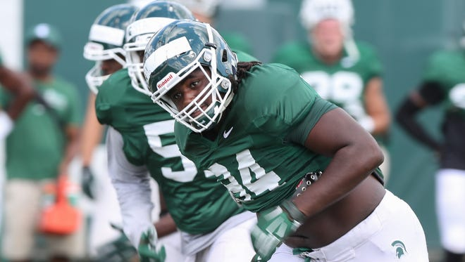 Michigan State defensive end Auston Robertson goes through drills during practice in East Lansing on Aug. 22, 2016.
