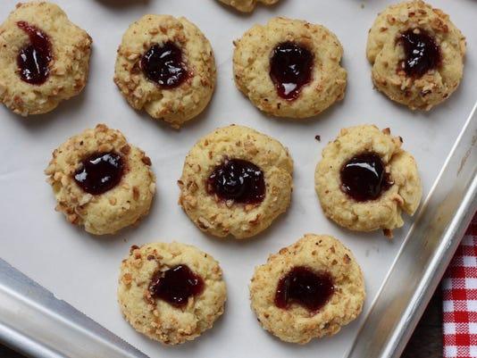 636480858389893454-raspberry-hazelnut-thumbprint-cookies.jpg