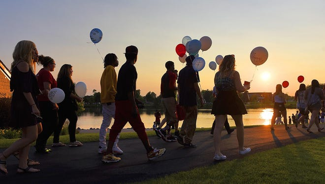 Friends of Davee Devose walked to Lake George on Wednesday from where he was killed to release balloons with personal messages written on them to say their goodbyes.